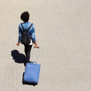 woman wheeling a bag